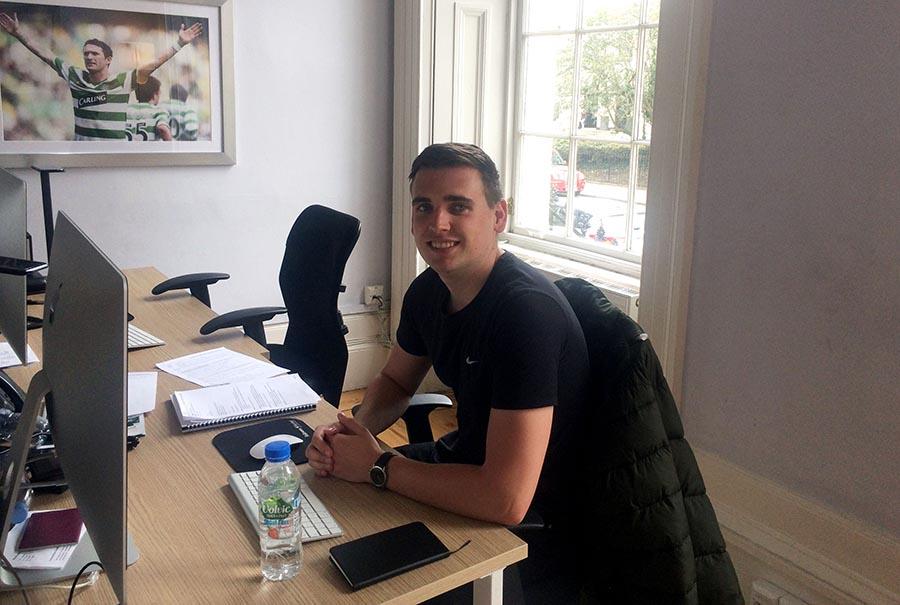 Angus at his desk at SNS Group