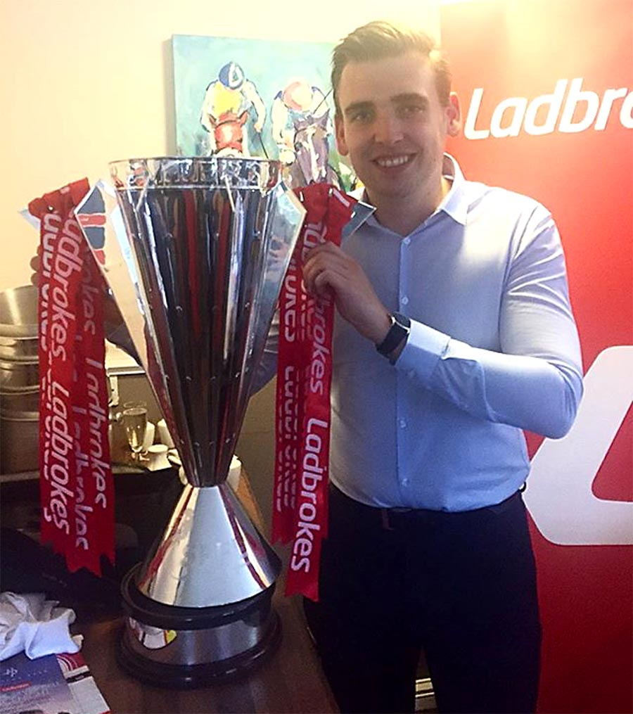 Angus with Ladbrokes trophy at a work event