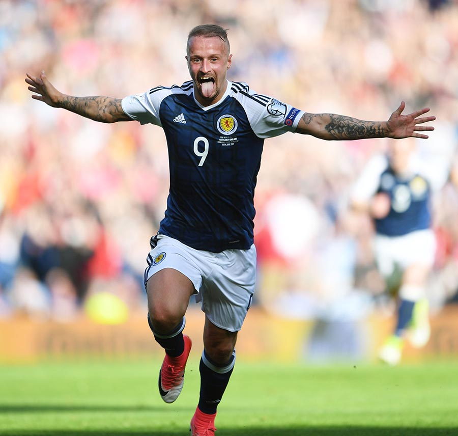 Leigh Griffiths celebrates with arms open and tongue out after scoring a goal for Scotland