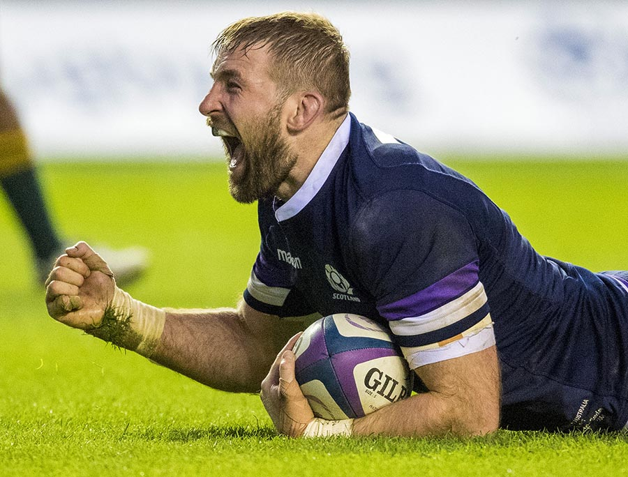 Scotland's John Barclay lies on the ground and cheers as he celebrates his try