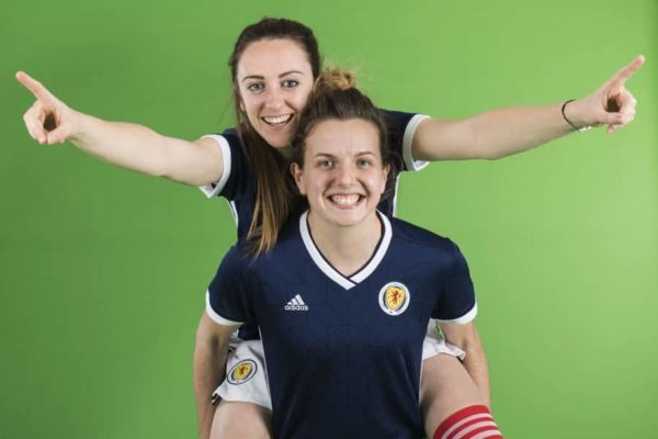Two Scotland Women's Team players pose in kit