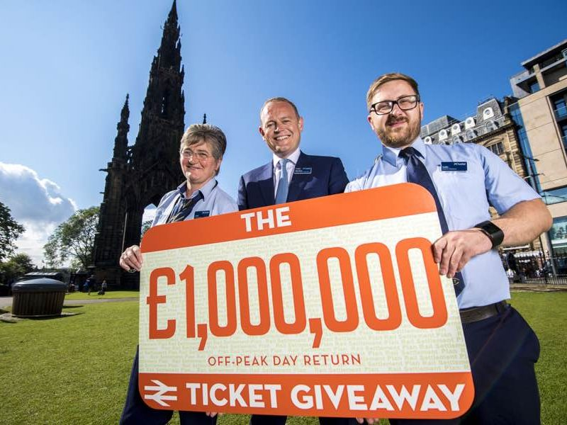 Fiona Nicol, Scotrail Managing Director Alex Hynes and Ivelin Bilcher promoting a giveaway, Edinburgh
