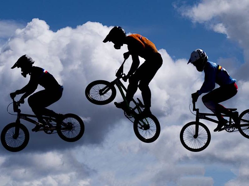 Three BMX riders in action at Knightswood, Glasgow 2018