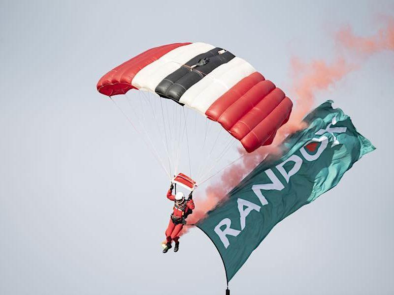 Man parachuting at Randox annual polo weekend atThe Gleneagles Hotel