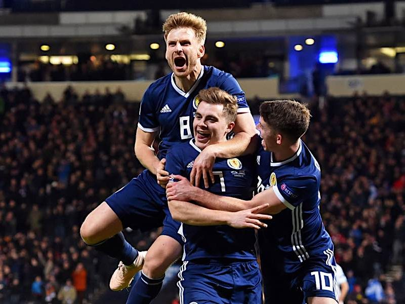 James Forrest celebrates with Stuart Armstrong and Ryan Christie after scoring against Israel in 2018
