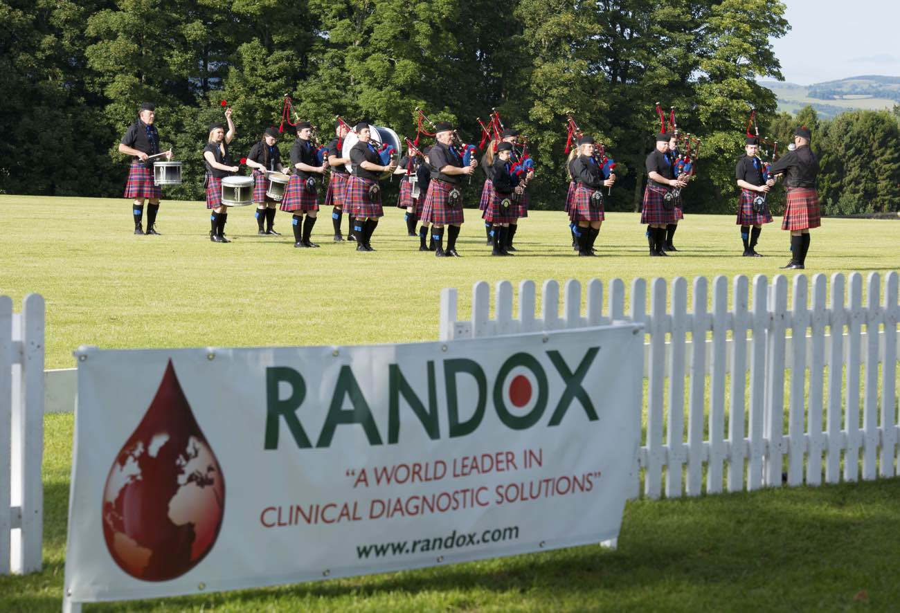 Bag pipe player at the Randox annual polo weekend at The Gleneagles Hotel