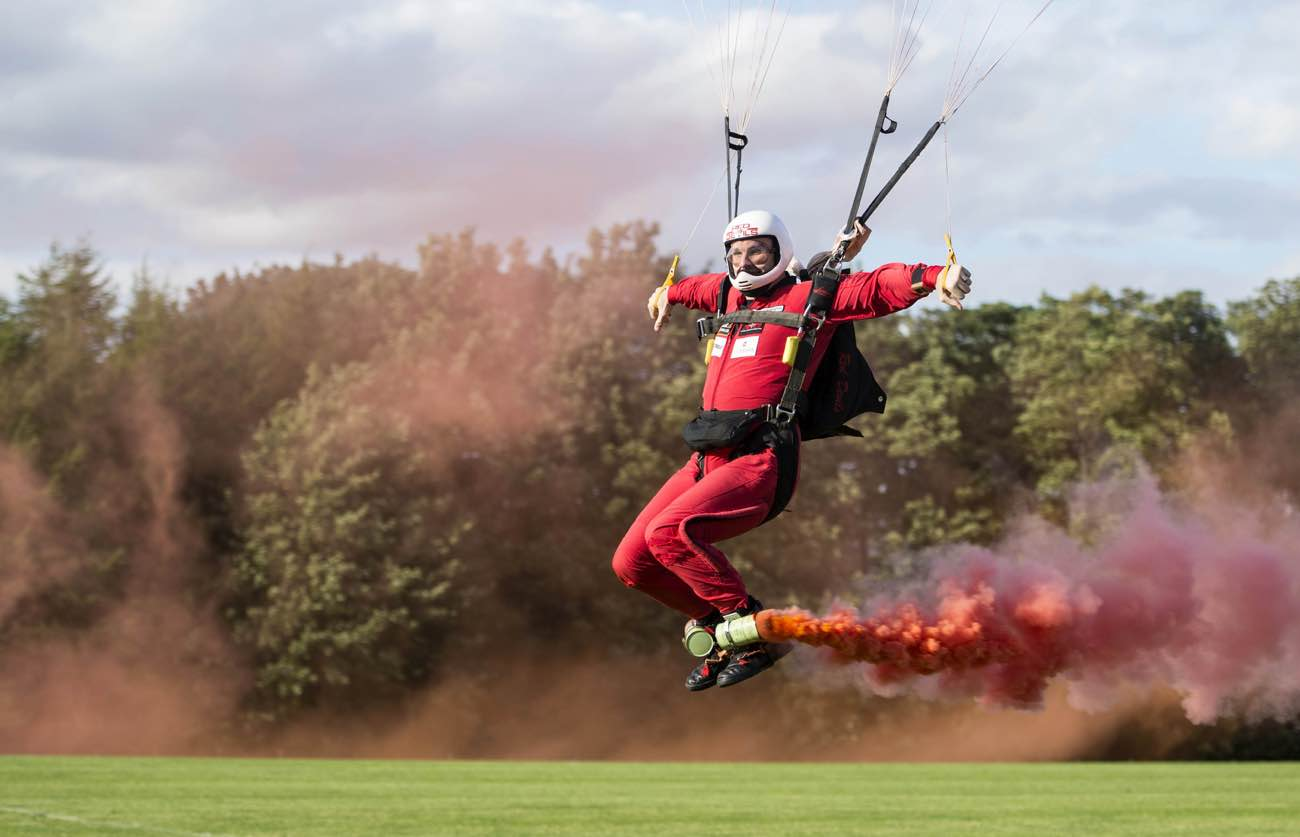 Man landing from parachute at the Randox annual polo weekend at The Gleneagles Hotel