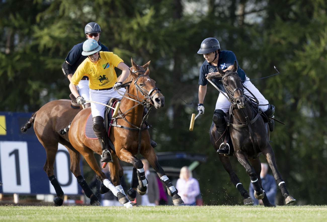 Men playing polo at Randox annual polo weekend at The Gleneagles Hotel