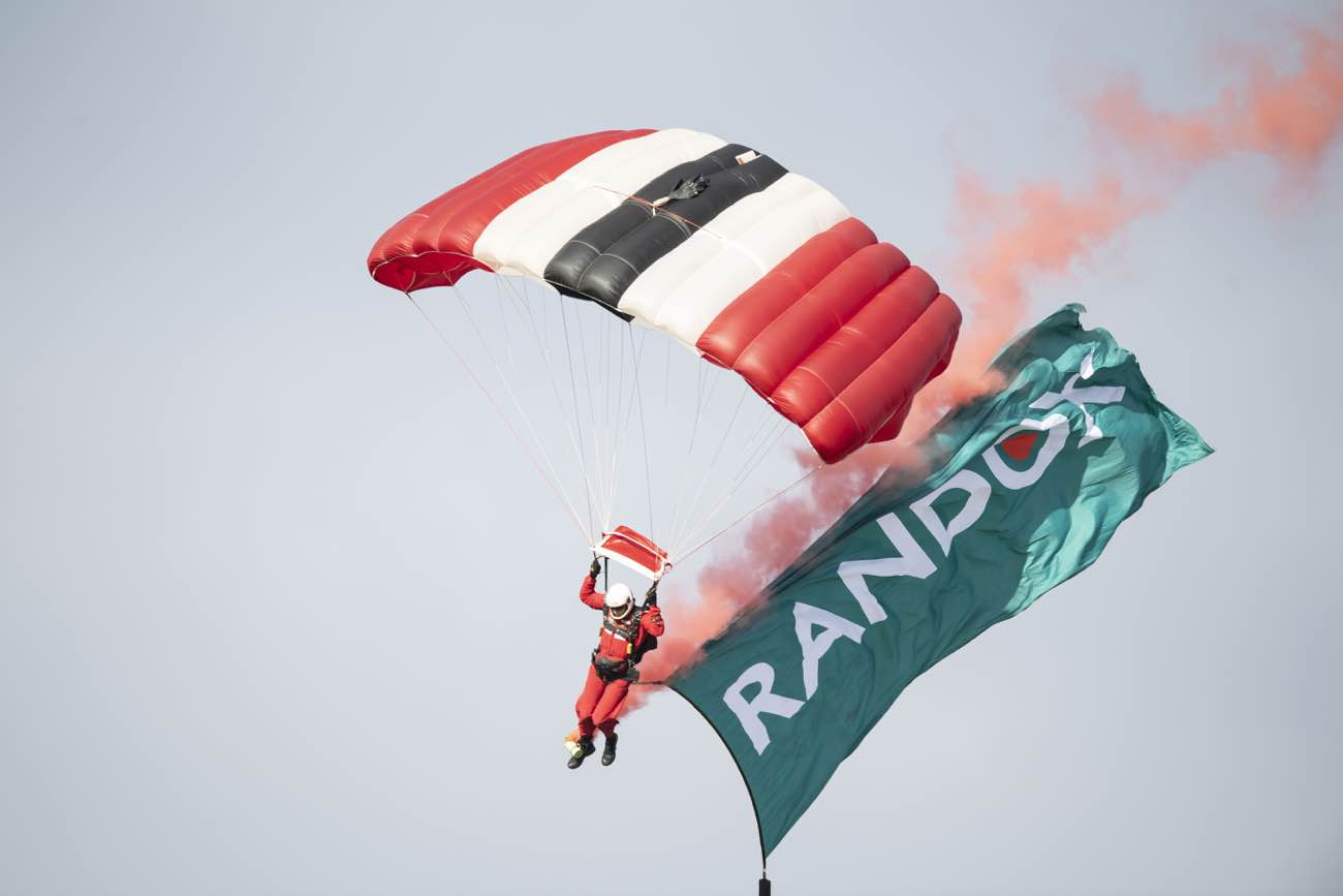 Man parachuting at Randox annual polo weekend at The Gleneagles Hotel