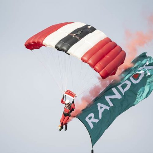 Man parachuting at Randox annual polo weekend atThe Gleneagles Hotel