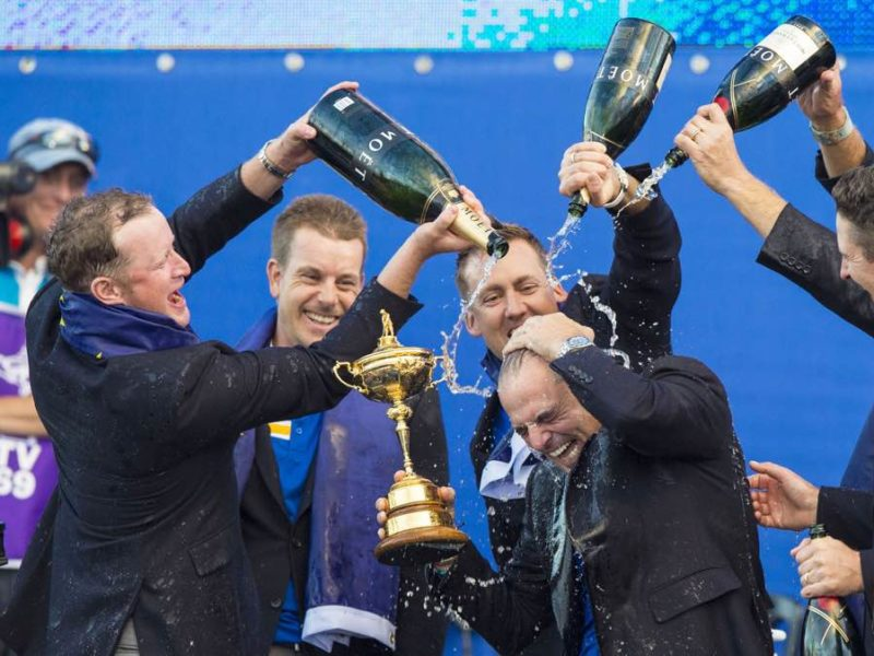 European captain Paul McGinley is soaked with champagne