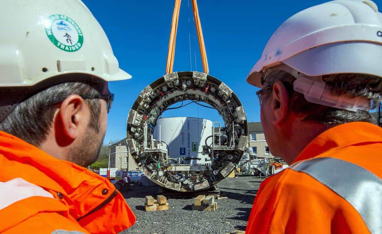 Workers looking at the Shieldhall Tunnel Boring Machine at Scottish water