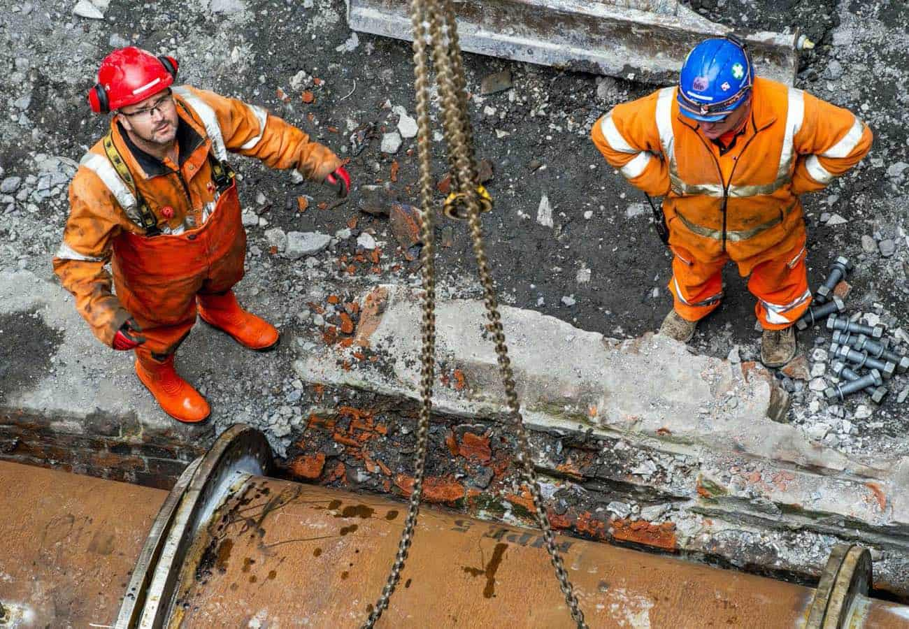 Two men working from Scottish Water